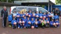 DFB-Trainer und die E-Jugend vor dem DFB-Mobil